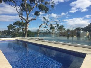 Frameless-Glass-Pool-Fence-with-stainless-steel-top-rail-Blakehurst-300x225
