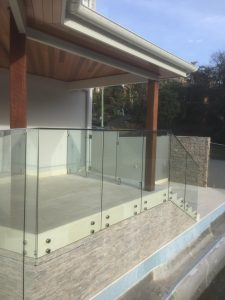 Frameless-Glass-Balustrade-using-standoff-pins-Forresters-Beach-225x300