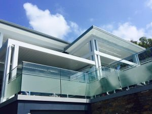 Frameless-Glass-balustrade-with-spigots-top-rail-and-frosted-300x225