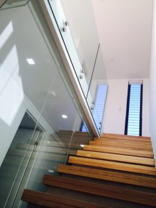 Frameless-Glass-on-stairs-with-stand-off-pins-225x300