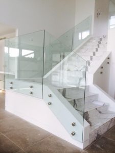 Frameless-glass-on-internal-stairs-with-stand-off-pins-2-225x300