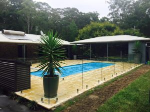 Frameless-glass-pool-fence-with-polished-spigots-300x225