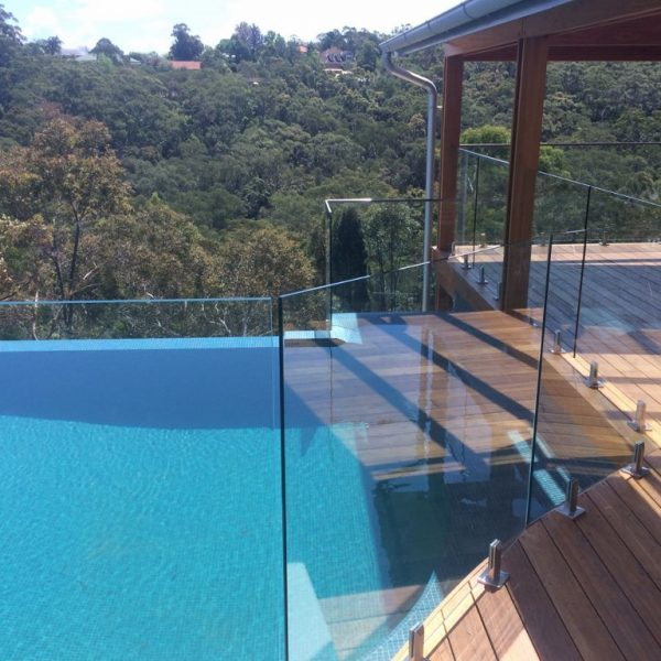 PFI Glass- deck mounted spigots -frameless pool fence