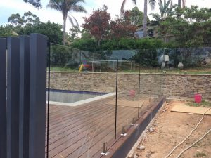 PFI-Glass-framelss-glass-pool-fence-on-deck-300x225