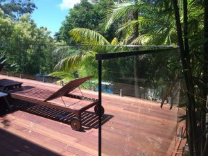 PFI-Glass-mounted-on-timber-deck-with-top-rail-300x225