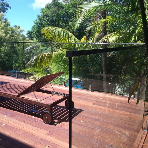 PFI Glass-mounted on timber deck with top rail