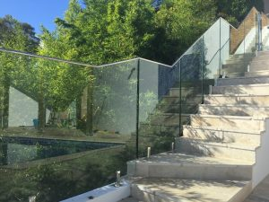 frameless-glass-balustrade-with-raked-panels-on-external-stairs-with-top-rail-and-spigots-300x225