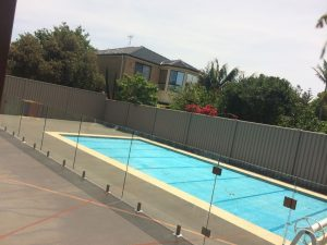 frameless-glass-pool-fence-with-core-drilled-spigots-by-Pro-fit-Installations-300x225